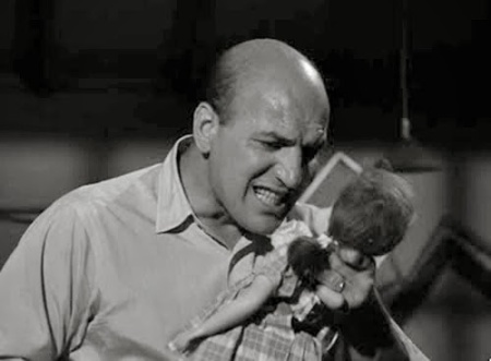 Telly Savalas holds doll in Twilight Zone