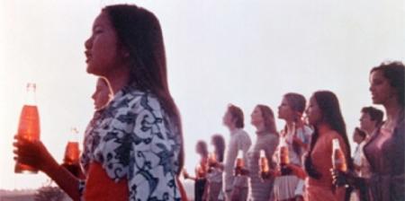 people on hillside with Coke bottles