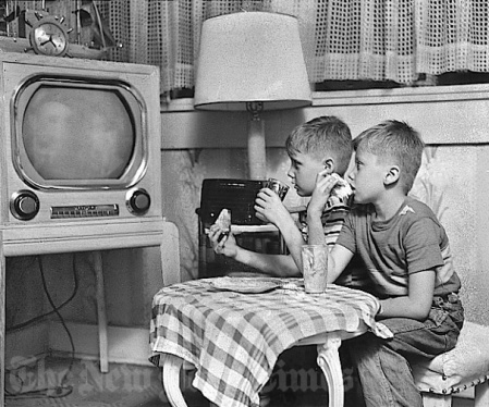 Two boys watching vintage TV