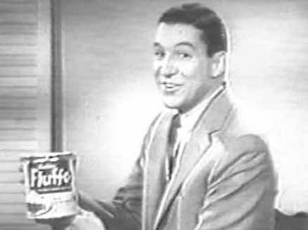 Mike Wallace holds can of Fluffo