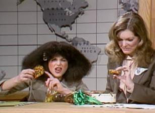 Roseanne Roseannadanna and Jane Curtin with fruitcake