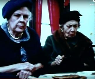Two ladies eat pancakes