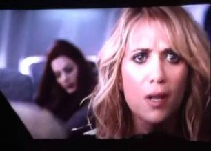 Kristin Wiig on plane in Bridesmaids