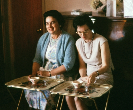 two women eating on TV trays