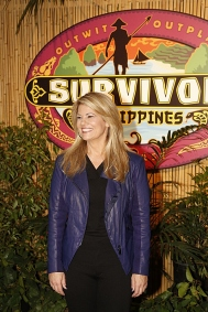 lisa whelchel with survivor backdrop