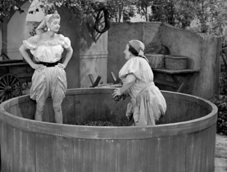 Lucy and Italian woman in grape vat