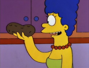 Marge Simpson holds potato