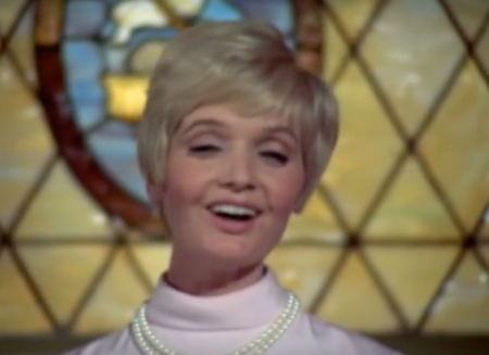 Carol Brady sings in church