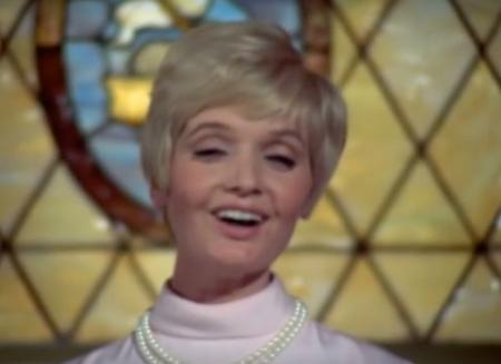 Carol Brady sings in church