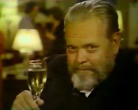 Orson Welles holding champagne glass