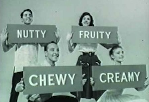 people hold signs that say nutty, fruity, chewy, creamy