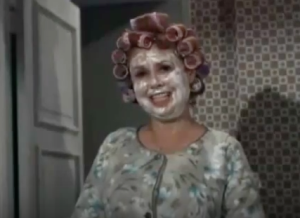 Mrs. Kravitz in curlers with cold cream on her face