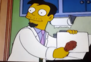Dr. Nick rubs fried chicken leg against paper