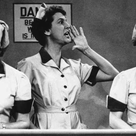 Lucy and Ethel in chocolate factory with mouths full of chocolate