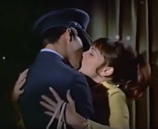 Moondoggie and Gidget kiss