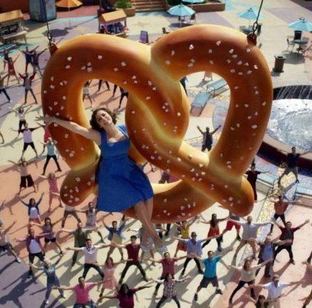 Rebecca rides a pretzel into the sky in Crazy Ex-Girlfriend
