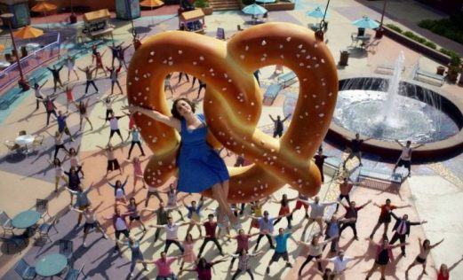 Rebecca rides a pretzel into the sky in Crazy Ex-Girlfriend